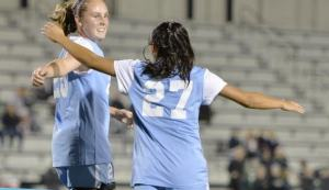 HOPKINSSPORTS.COM Freshman Kristen Hori (27) celebrates with her teammate on Oct. 17.