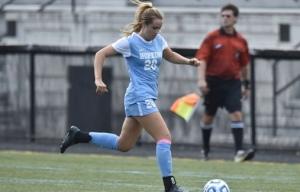 HOPKINSSPORTS.COM Senior Maryalice McKenna dribbles upfield against Swarthmore.