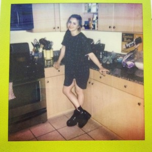 COURTESY OF MIA CAPOBIANCO The gorgeous Kate Buchser in her apartment before a night out.