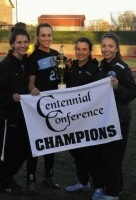 HOPKINSSPORTS.COM The women's soccer captains  celebrate their conference title.